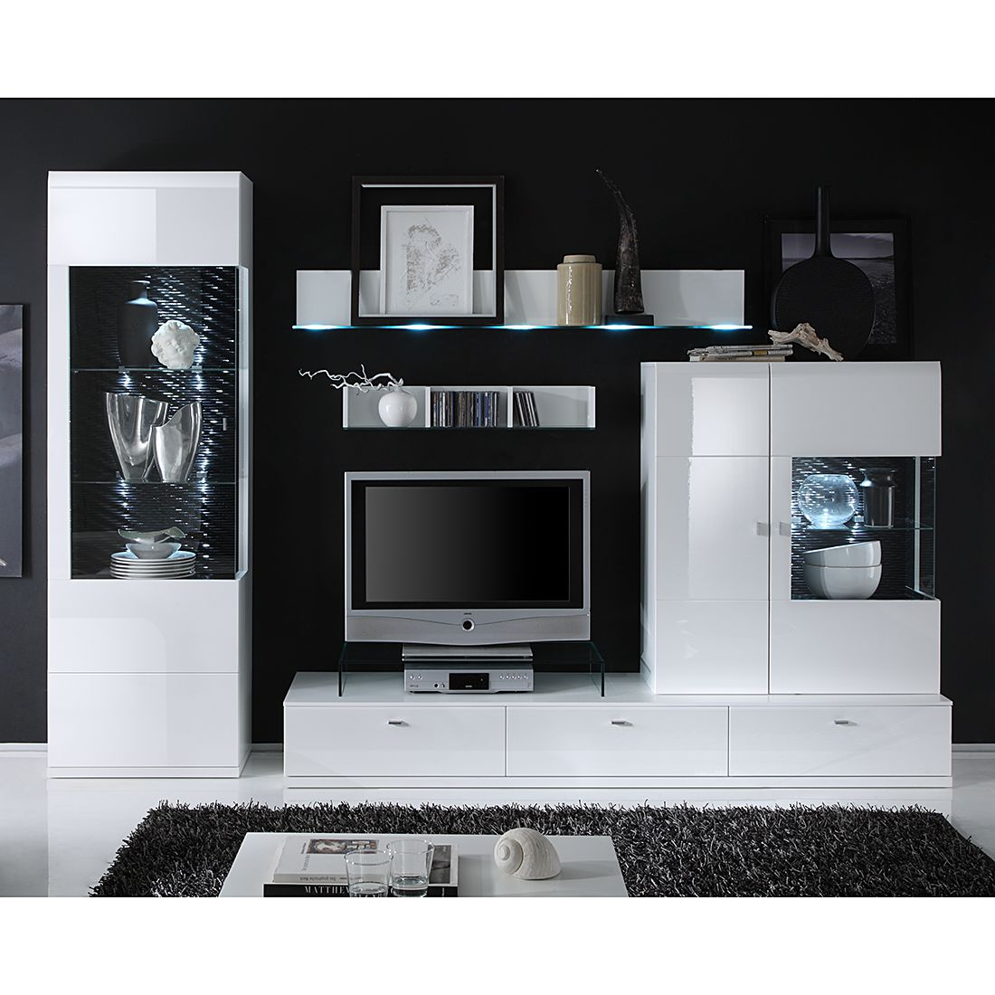 eek a wohnwand tesseo ii 4 teilig hochglanz wei absetzung schwarz mit beleuchtung tv. Black Bedroom Furniture Sets. Home Design Ideas